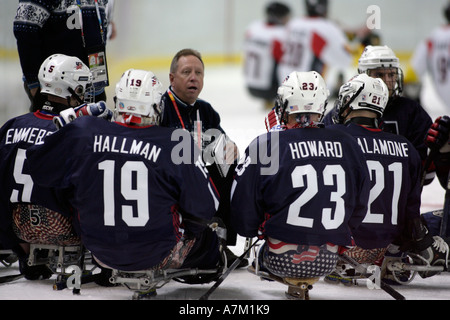 Team USA coach gives his team a pep talk during the opening game - Stock Photo