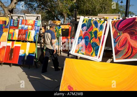 Paintings on sale at a street market in Havana Cuba - Stock Photo