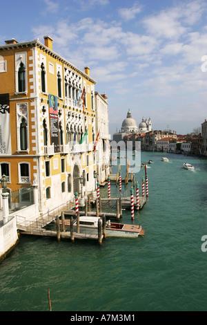 Water taxi boats cruise down the Grand Canal towards the famous Chiesa di Santa Maria della Salute Venice Italy - Stock Photo