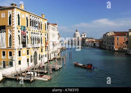A water taxi carrying tourists crosses the Grand Canal near the Ponte dell Academia Venice Italy Europe EU - Stock Photo