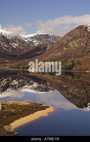 Reflections in Loch Muick, Aberdeenshire, showing Broad Cairn (998metres) and Glas-allt Shiel lodge. Scotland. - Stock Photo