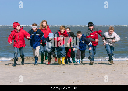 Crowd Of Kids Between 8 And 12 Years Old Running On The Beach Northsea