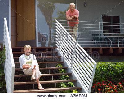 Senior man standing on his veranda, looking proud Stock Photo: 209601213 - Alamy