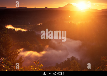 Sunrise over Mt Hood, with the Sandy River covered in fog as seen from Jonsrud Viewpoint near Sandy, Oregon. - Stock Photo