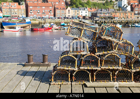 LOBSTER POTS ON HARBOUR SIDE AT WHITBY FISHING VILLAGE YORKSHIRE ENGLAND - Stock Photo