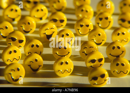 Still life of a group of yellow happy faces with various expressions - Stock Photo