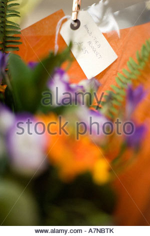 25 price tag on hand tied bouquet in flower shop close up focus on background - Stock Photo