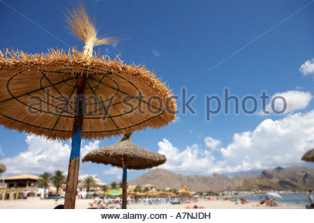Republic of South Africa Cape Town palapa sunshades on sandy beach resort in background focus on foreground - Stock Photo