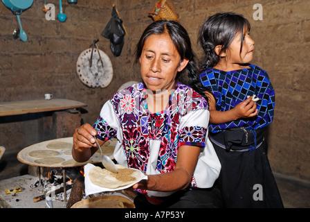 Maya woman baking tortillas Chiapas Mexico - Stock Photo