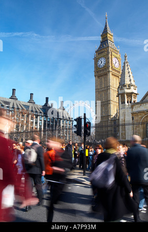 Pedestrians crossing the road from Parliament Square SW1 towards Big Ben in London City England UK - Stock Photo