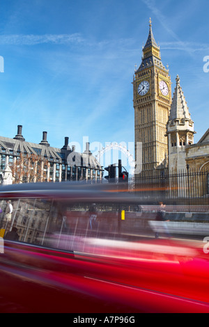 Taxi speeding past Big Ben at Parliament Square SW1 in London city England UK 16 03 2007 - Stock Photo