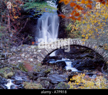 Old stone bridge and waterfall in Glen Lyon, Perth and Kinross, Scotland, UK - Stock Photo