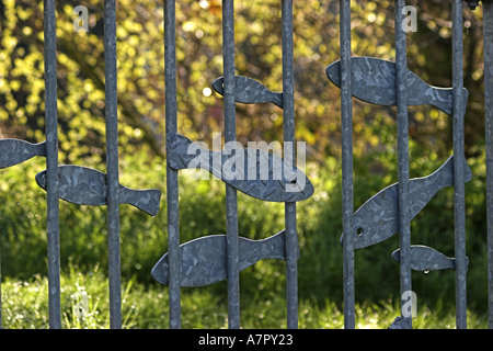 Railings With Fish Art Decoration - Stock Photo