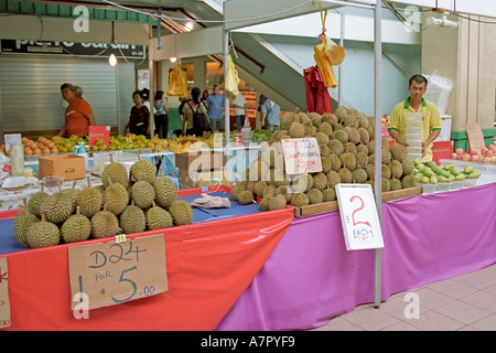 Selection of durians for sale on a small street fruit market in Chinatown, Singapore. - Stock Photo
