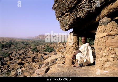 Mali, Dogon Country, village of Tereli, a man sitting under the Toguna (talking hut) - Stock Photo
