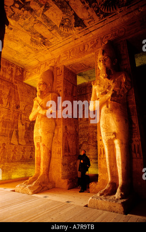 Egypt, Nile Valley, Abu Simbel, Great Temple of Ramses II (osiride pillars with the effigy of Ramses II supporting - Stock Photo
