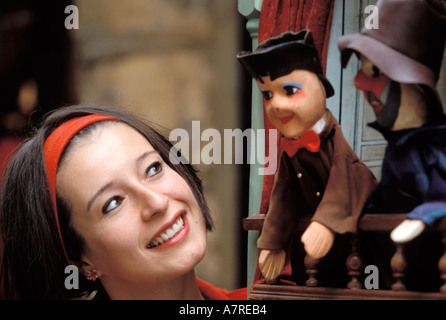 Woman Watching Puppet Show - Stock Photo