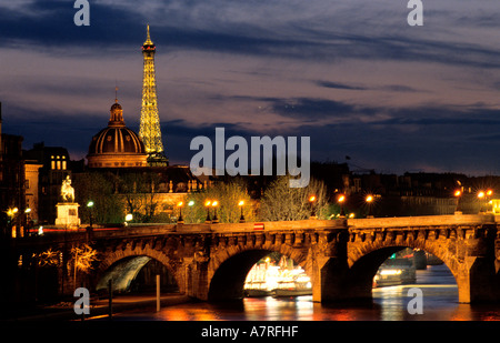 France, Paris, Pont Neuf, Seine river and the Eiffel Tower with its night lightning by Pierre Bideau (Reproduction - Stock Photo