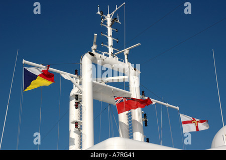 Flags and communications antennae on the mast of the cruise ship Aurora - Stock Photo