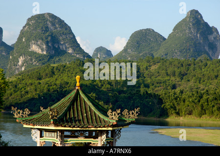China, Guangxi, Yangshuo County - a typical Chinese pavilion on the Li River in the evening - Stock Photo
