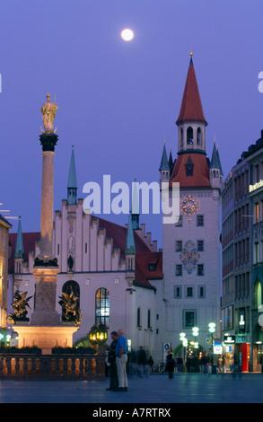 Monument lit up at city square Mary Column Marienplatz Munich Germany - Stock Photo