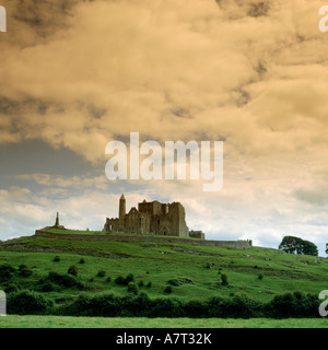 Low angle view of palace on hill under cloudy sky, Rock Of Cashel, Republic of Ireland - Stock Photo