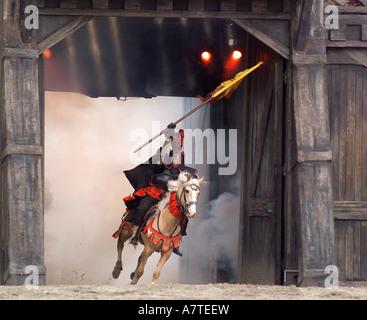 Knight riding on horse, Bavaria, Germany - Stock Photo