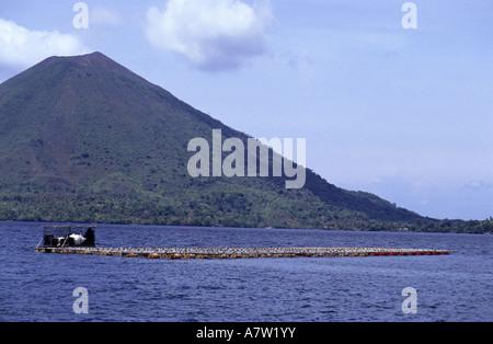 Oyster farm and Api volcano Gunung Api Banda island Moluccas islands Indonesia - Stock Photo
