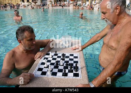Men playing chess at Szechenyi thermal baths in Budapest Hungary - Stock Photo