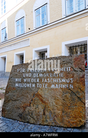 Memorial stone against war and fascism in front of the birth place of Adolf Hitler Braunau upon the river Inn Upper - Stock Photo