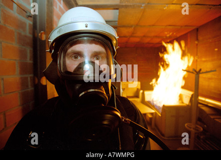 Fire fighter with breathing protection in a fire practice.Koblenz, Rhineland-Palatinate, Germany - Stock Photo