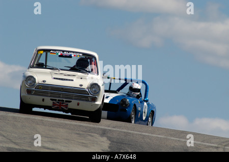 Don Heth in his 1966 Cortina Lotus followed by Ken Holley in his 1965 Sprite at the Vintage Grand Prix Au Grattan - Stock Photo