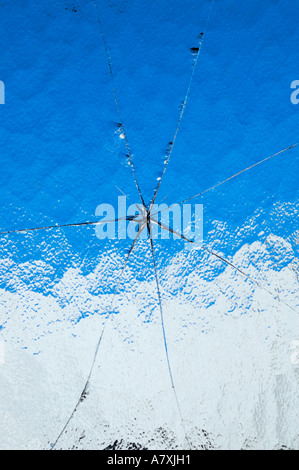 Cracks in ripple / ribbed glass - Stock Photo