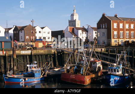 PORTSMOUTH OLD HARBOUR Town Camber fish docks with colourful fishing boats in water. Portsmouth Hampshire England - Stock Photo