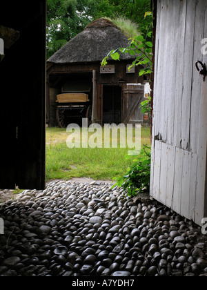 Cobble stone paving at old farm Hjerl Hede open air museum Sevel jutland Denmark - Stock Photo