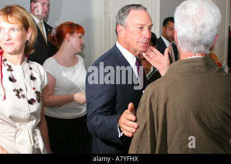 New York City mayor Michael Bloomberg greets supporters at an event in the summer of 2006 - Stock Photo