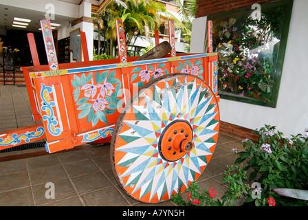 Costa Rica, San Jose, Bouganvilla Hotel decorative coffee ox cart - Stock Photo