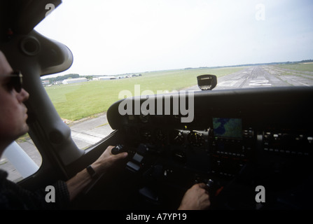 Light aircraft on final approach - Stock Photo