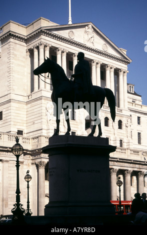 Silhouette of Duke of Wellington & horse statue with sunny Bank of England beyond in Threadneedle Street financial - Stock Photo