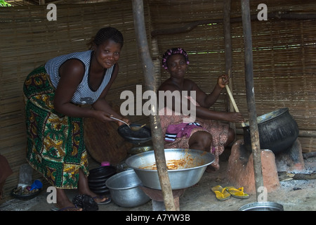 Village women preparing Banku a traditional Ghanaian dish using Cassava and maize corn flour to produce a fermented - Stock Photo