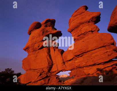 Legendary Pike's Peak seen through a window in the Colorado redrock at dawn. - Stock Photo