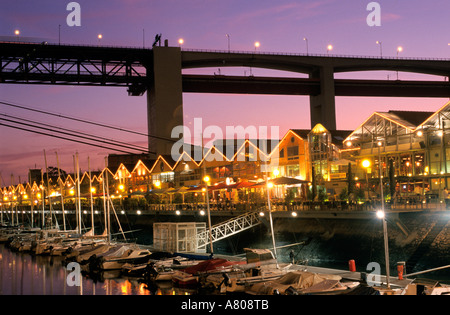 Portugal, Estramadura Province, Lisbon, Docas de Alcantara, Tagus river bank under the April 25 Bridge, bars and - Stock Photo