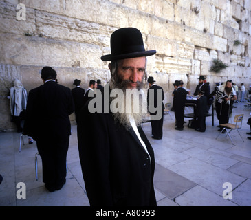 Orthodox Jew at the Western Wall or Wailing Wall in Jerusalem Israel - Stock Photo