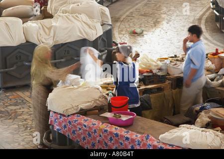 Customer And Vendor In Chorsu Indoor Market - Stock Photo