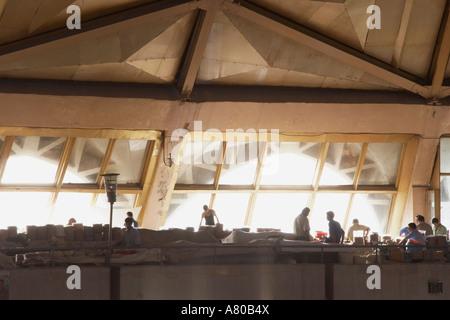 Workers Silhouetted Against Window In Chorsu Indoor Bazaar - Stock Photo