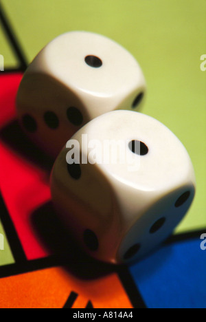 Close up of two dice on a Monopoly game board - Stock Photo