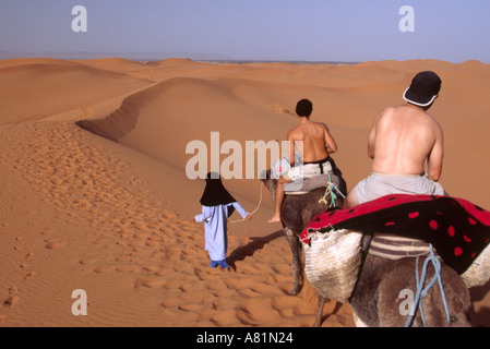 Camel trekking - Merzouga, Erg Chebbi, MOROCCO - Stock Photo