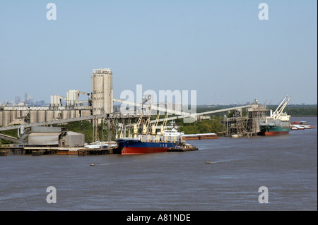 Commercial ships on the mississippi river near New Orleans - Stock Photo