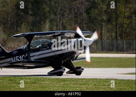 Pitts S 2B Aerobatic Biplane piloted by Ken Apposetto taxis for takeoff at the Slidell Air Show in Slidell Louisiana - Stock Photo