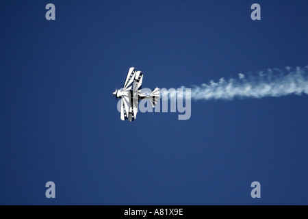 Pitts S 2B Aerobatic Biplane piloted by Ken Apposetto performs stunts at the Slidell Air Show in Slidell Louisiana - Stock Photo